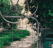 Leafy gate with a bicycle wheel decoration Sticker