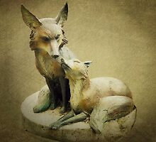 Stone Foxes by debidabble