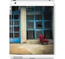 Industrial exterior with red chair and window iPad Case/Skin