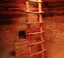 Sunlight shines in Kiva Ladder Opening by Roupen  Baker