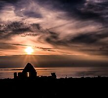 Sunset over Dunluce Castle Window, Northern Ireland by Alan Campbell