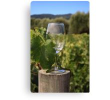 Wine glass on a log Canvas Print