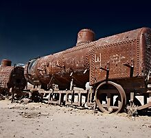 train cemetery at  Salar de Uyuni by travel4pictures