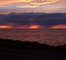 Sunset storm cloud rains down on the Sea by DanByTheSea