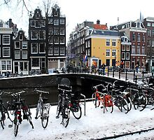 Bikes in the snow at Amsterdam by jchanders