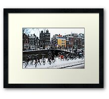 Bikes in the snow at Amsterdam Framed Print