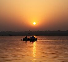 Boating on the River Ganges at dawn. by John Dalkin