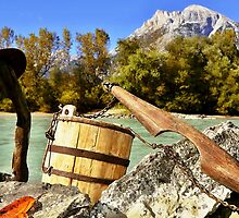 A Wooden Yoke On The River in Alps by Elzbieta Fazel