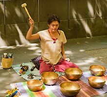 Playing Tibetan Singing Bowls by DavidsArt