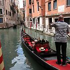 Canal traffic - San Marco, Venice, Italy by John Kleywegt