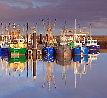 Reflections at the port of Lauwersoog by Natuuraandemuur