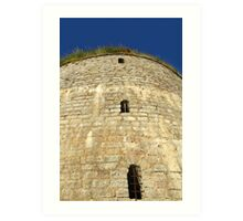 Old tower against the blue sky Art Print