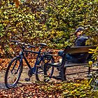 A bloke - a bike - a book - a break by © Kira Bodensted