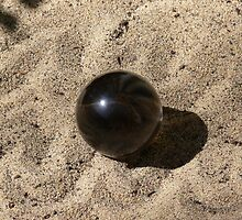 Sphere on waves of sand by Sandra Chung