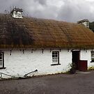 Old tatched and whitewashed Irish country cottage by Donny Ocleirgh