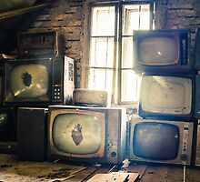 Old televisions in a dusty attic by cannedmoods