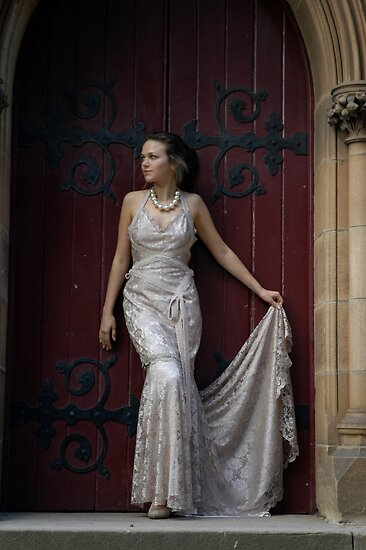 dress in front of church door by sunset
