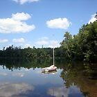 Sailboat on Glass Lake by Timothy  Ruf