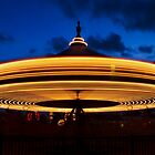 Carousel Spinning at Twilight by Kenneth Keifer