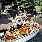 Old wooden water skiing boat at the Wide Waters Resort dock - 1960's by aladdincolor