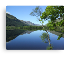 mirror calm scottish loch   Canvas Print