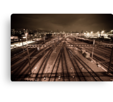 Train tracks in sepia by night. Canvas Print