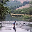 Girl playing in River Rydal Lake District England 198405200042 by Fred Mitchell