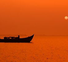peaceful scenic sunset with silhouette of a boat by Enjoylife
