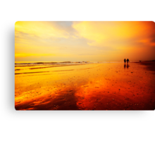 People walking on the beach Canvas Print