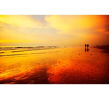 People walking on the beach Photographic Print