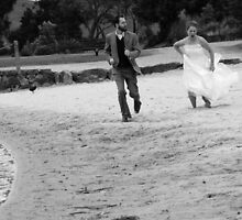 A leisurely race along the beach! by Rebecca  Nicolandos