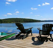 Chairs on dock by Elena Elisseeva