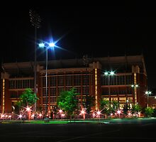 Oklahoma memorial stadium at night by mbuban