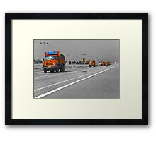 The Road To Tehran is Littered With Orange Trucks Framed Print