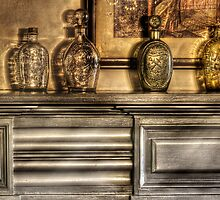 Mantle with a collection of bottles by Mike  Savad