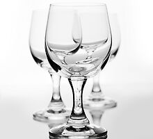 Three empty wine glasses on white  by Arletta Cwalina