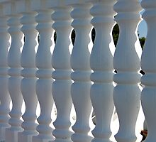 Decorative white stone fence  by Ron Zmiri