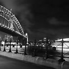 sydney harbour bridge and boat  at night  by chrisblackwell29