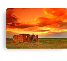 Lone house on fire. Canvas Print