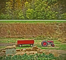 Old Classic Red Tractor and Wagon Trailer on Farm During Harvest by Adri Turner