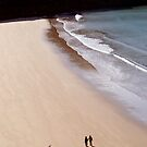 COUPLE WALKING ON PEMBROKESHIRE BEACH by kfbphoto