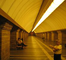Boy stretching at a metro station in Kiev by BrendanBurns