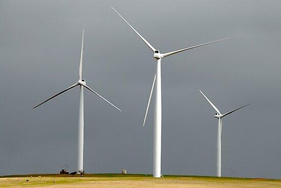Wind farm on a dark sky by sasjacobs