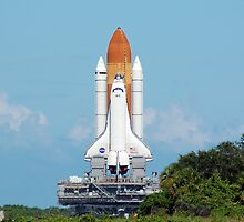 Shuttle Atlantis on the slow roll to the launch pad. by Mark Weaver