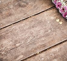 purple and mauve Flower frame on wood background  by PhotoStock-Isra