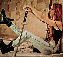 Aggressive Young woman of 24 with a Samurai Sword  by PhotoStock-Isra