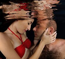 Romantic couple hugging underwater by PhotoStock-Isra