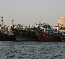 Cargo Ships docked in Dubai by Neil Grainger