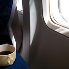 Cup of coffee in the plane	 by Efi Keren