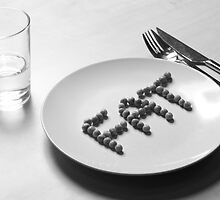 Anorexia. FAT spelt out with peas on a plate.  by PhotoStock-Isra